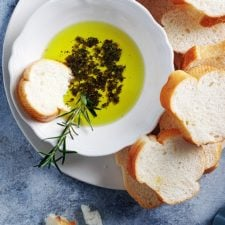 herbs & olive oil in a bowl with French bread