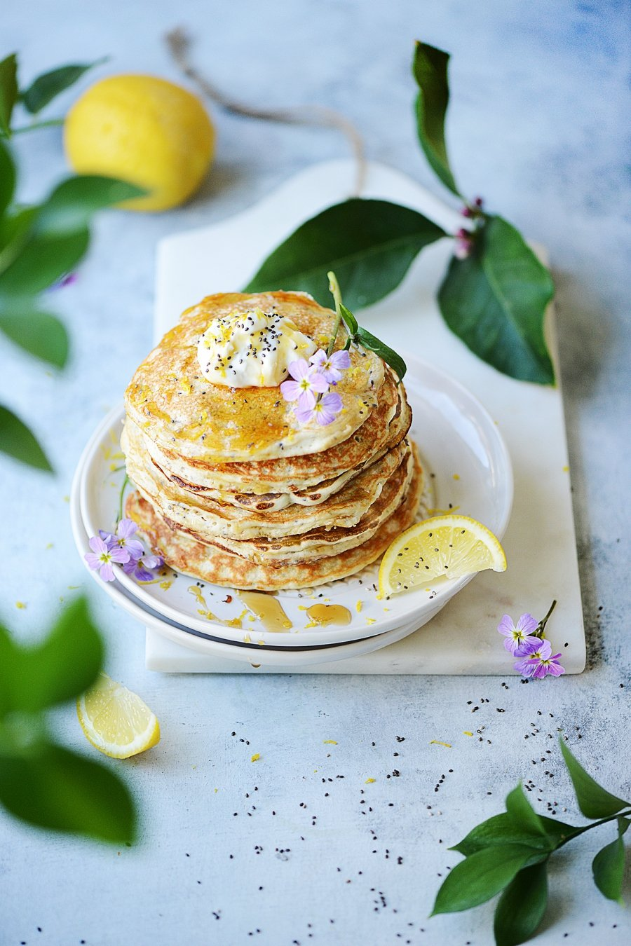 Lemon Pancakes on white plate with dripping syrup