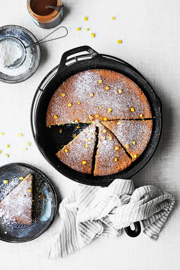 Black skillet with corn cake inside