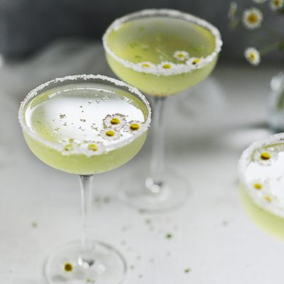 Cocktail drink with chamomile flowers as garnished