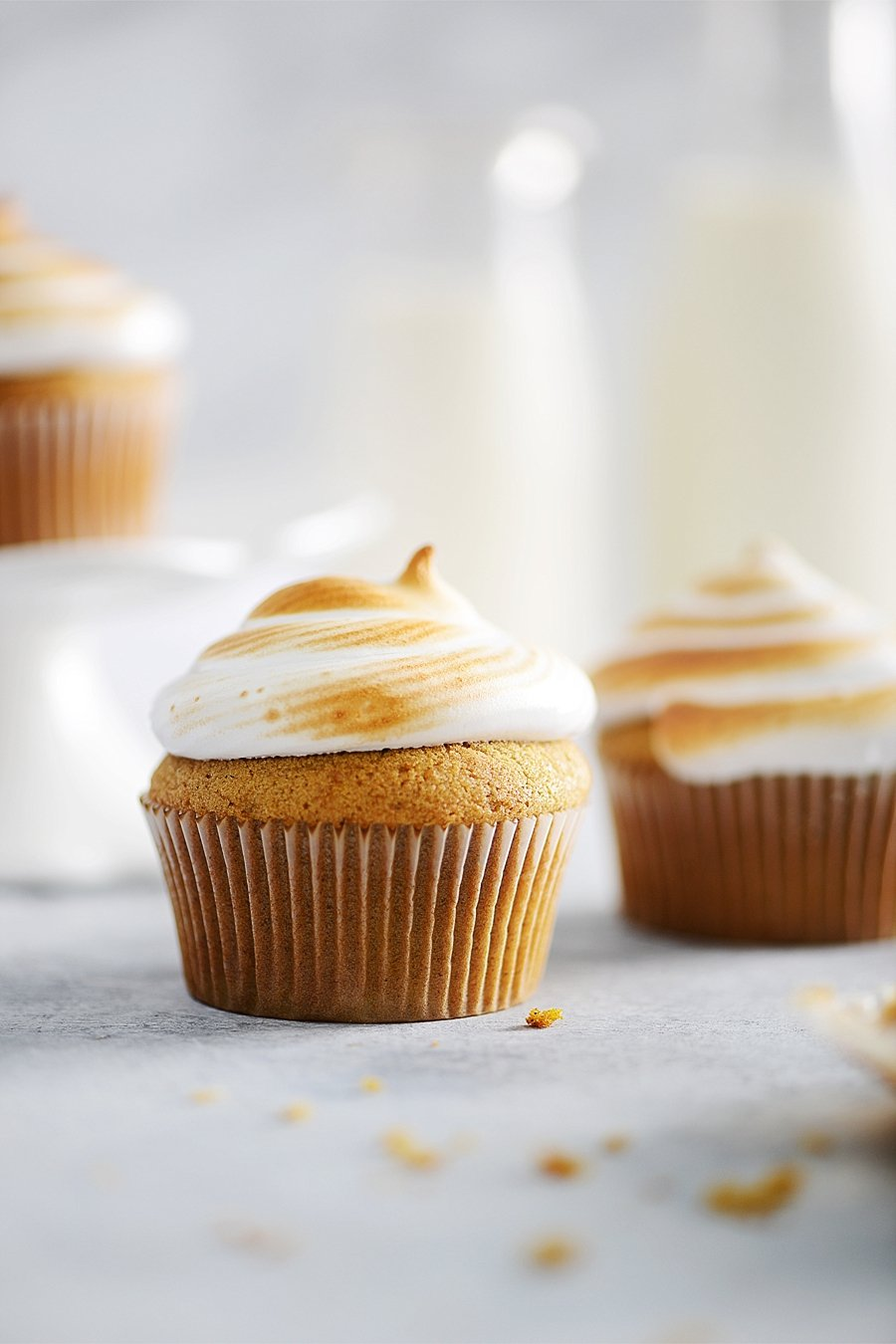 Pumpkin Cupcakes with Marshmallow Frosting by Muy Delish