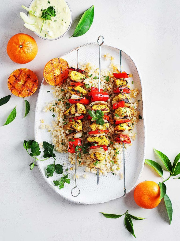 Moroccan Chicken Kebabs with onions and red bell peppers.