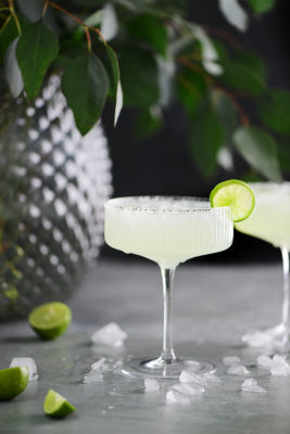 Margarita drinks garnished with limes