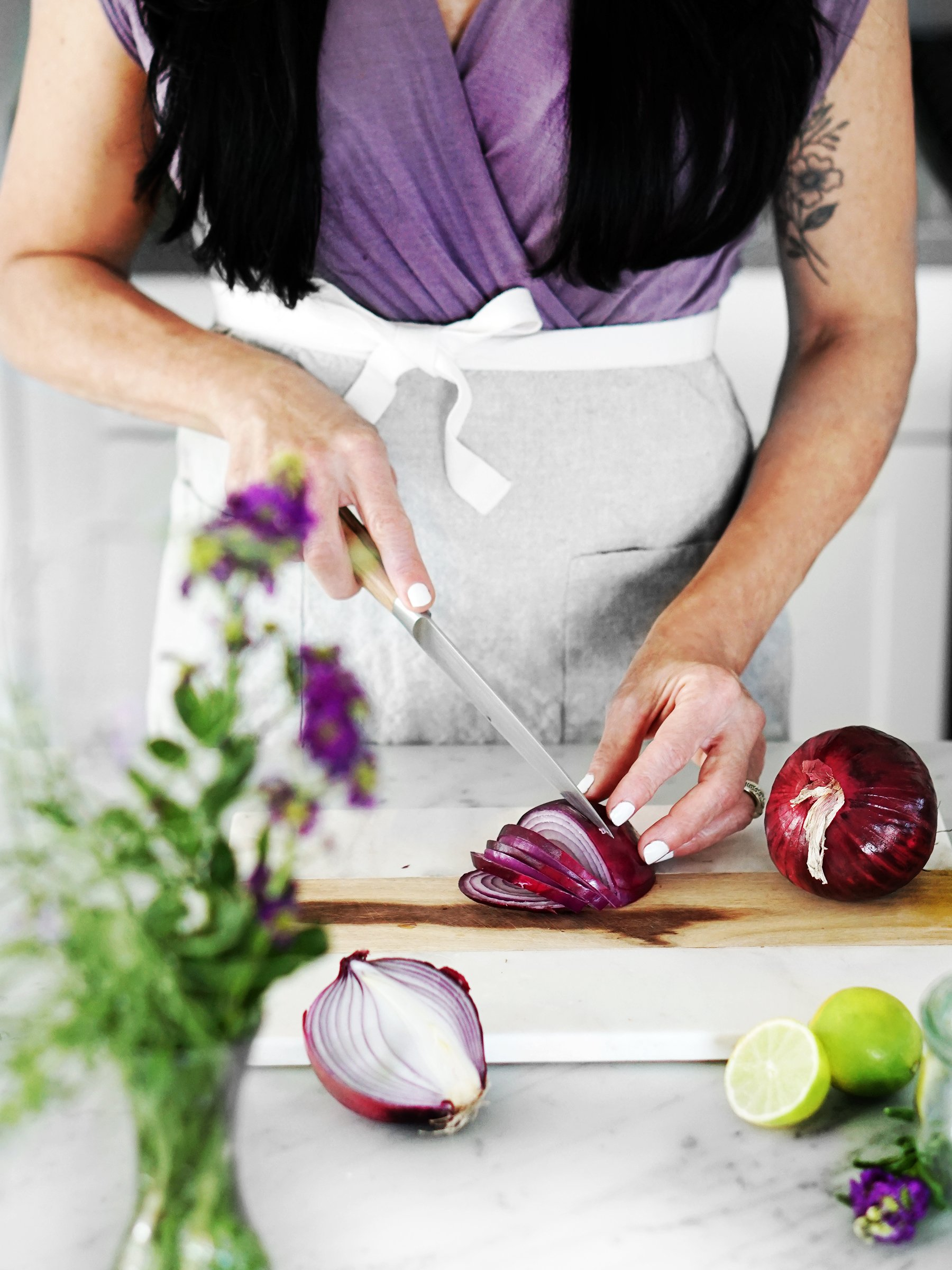 Woman slicing red onions