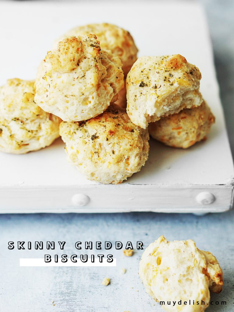 Overhead photo of 6 biscuits on top of a white board.