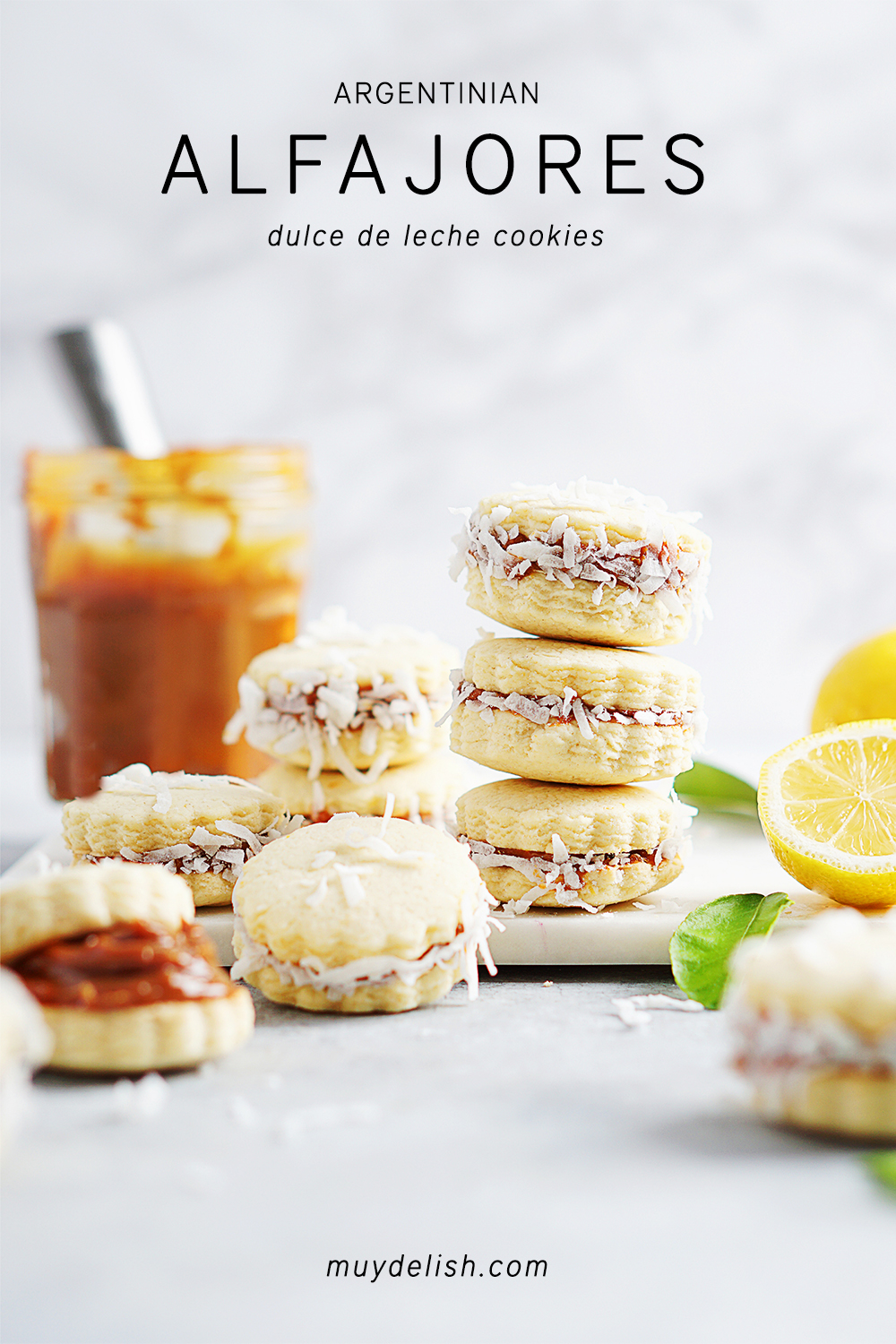 A stack of Alfajores and dulce de leech in background