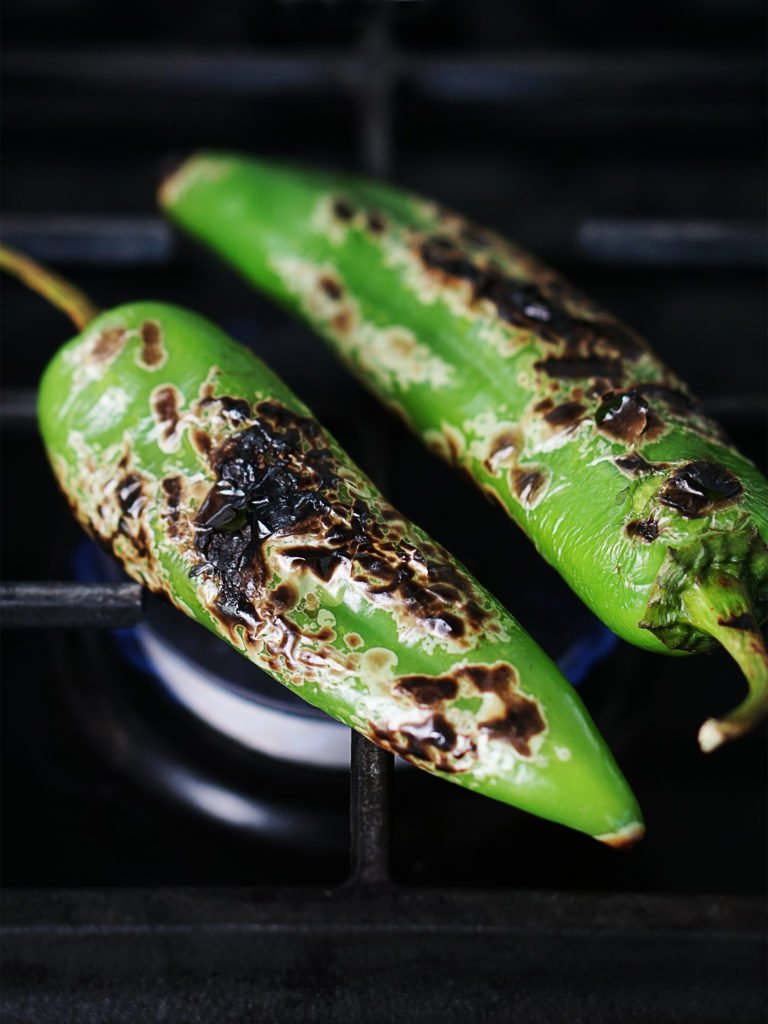 Peppers placed directly on the gas stove
