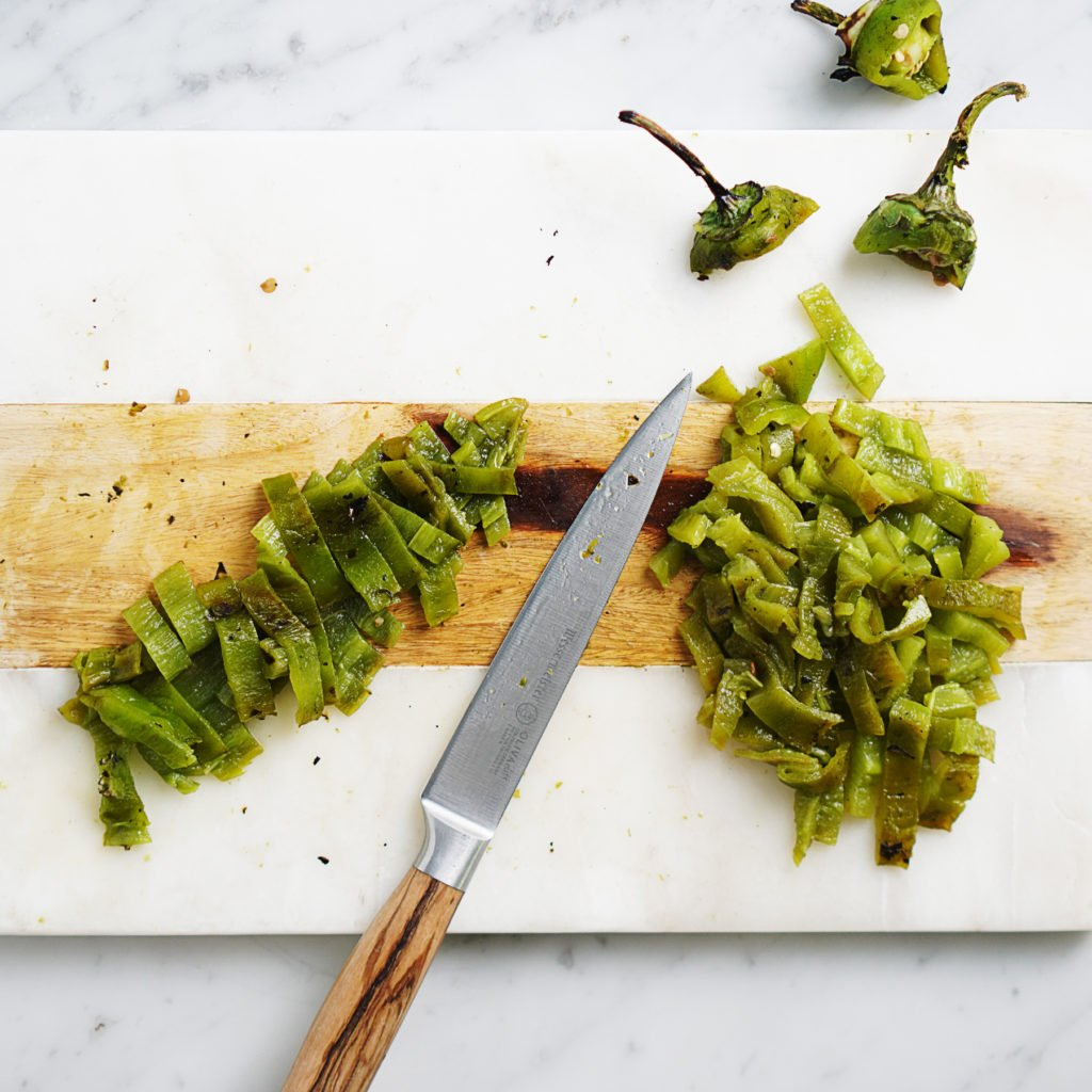 Green peppers sliced with a knife