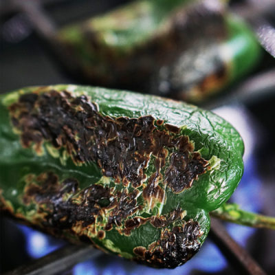 Roasting a poblano pepper on a gas stove