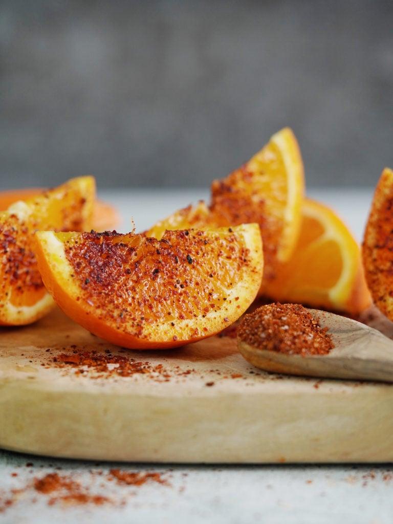 Orange slices with sprinkled chili powder