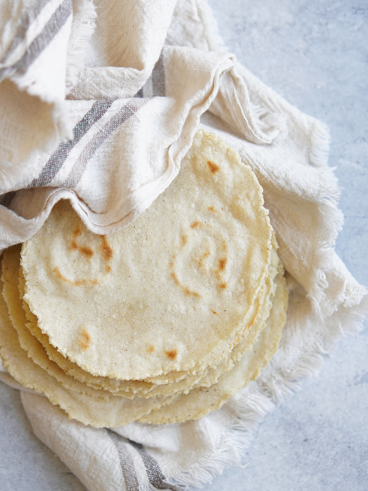 Tortillas inside a kitchen towel