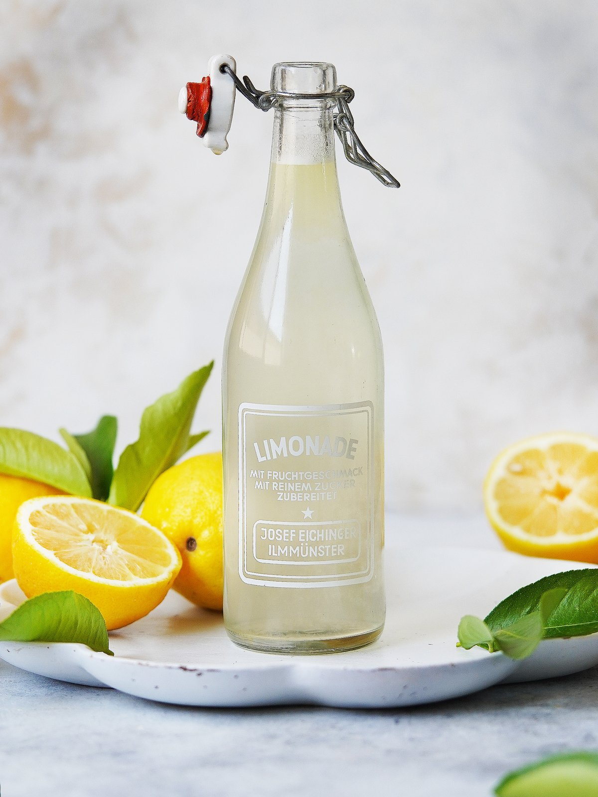 Limonada in a vintage bottle. Fresh lemons on the side