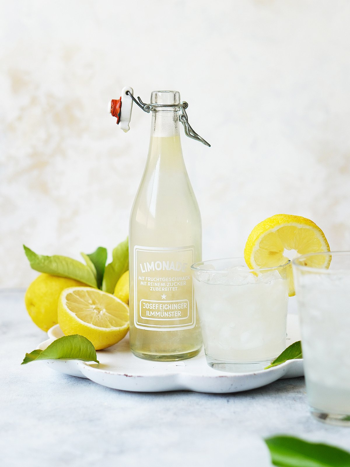 A white tray with a vintage bottle that says limonade
