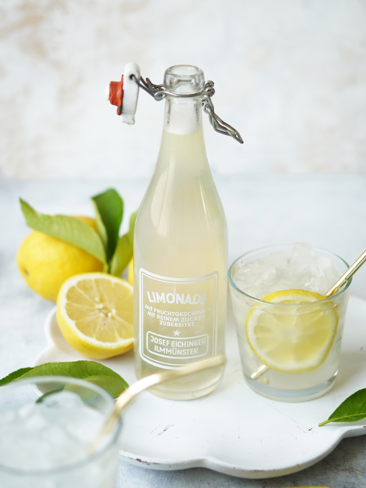 Limonada in a vintage bottle with a glass on the side