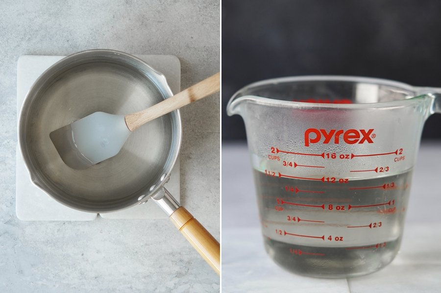 A saucepan with melted sugar and water plus a measurement cup with the simple syrup