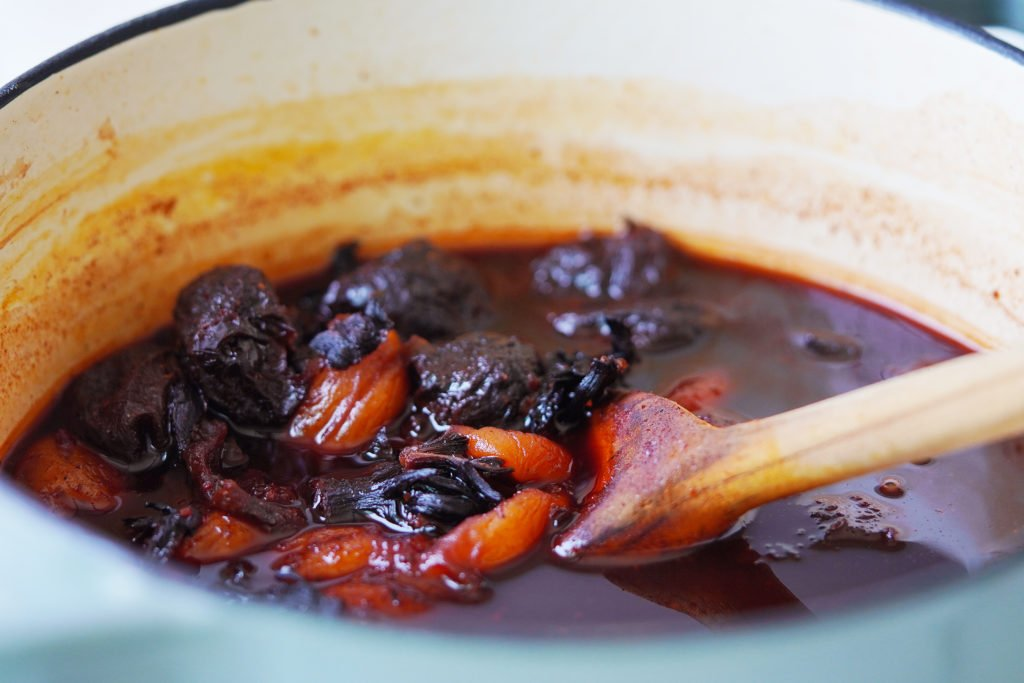 Cooked jamaica flowers, apricots and prunes in a saucepan