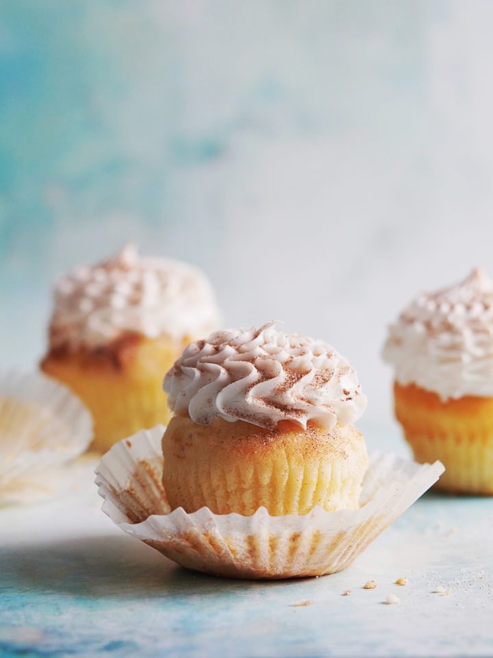 Three cupcakes with wrap folded down.