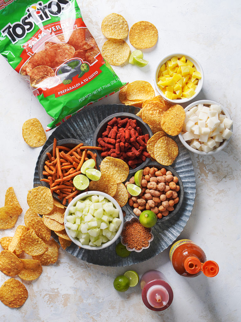 Ingredients: Tostitos Tortila Chips, tamarindo candy, cucumber, jicama, mango, chamoy, chili powder, valentina hot sauce, and more!