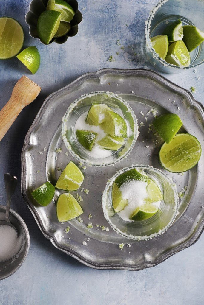 cut limes and sugar inside the 3 glasses