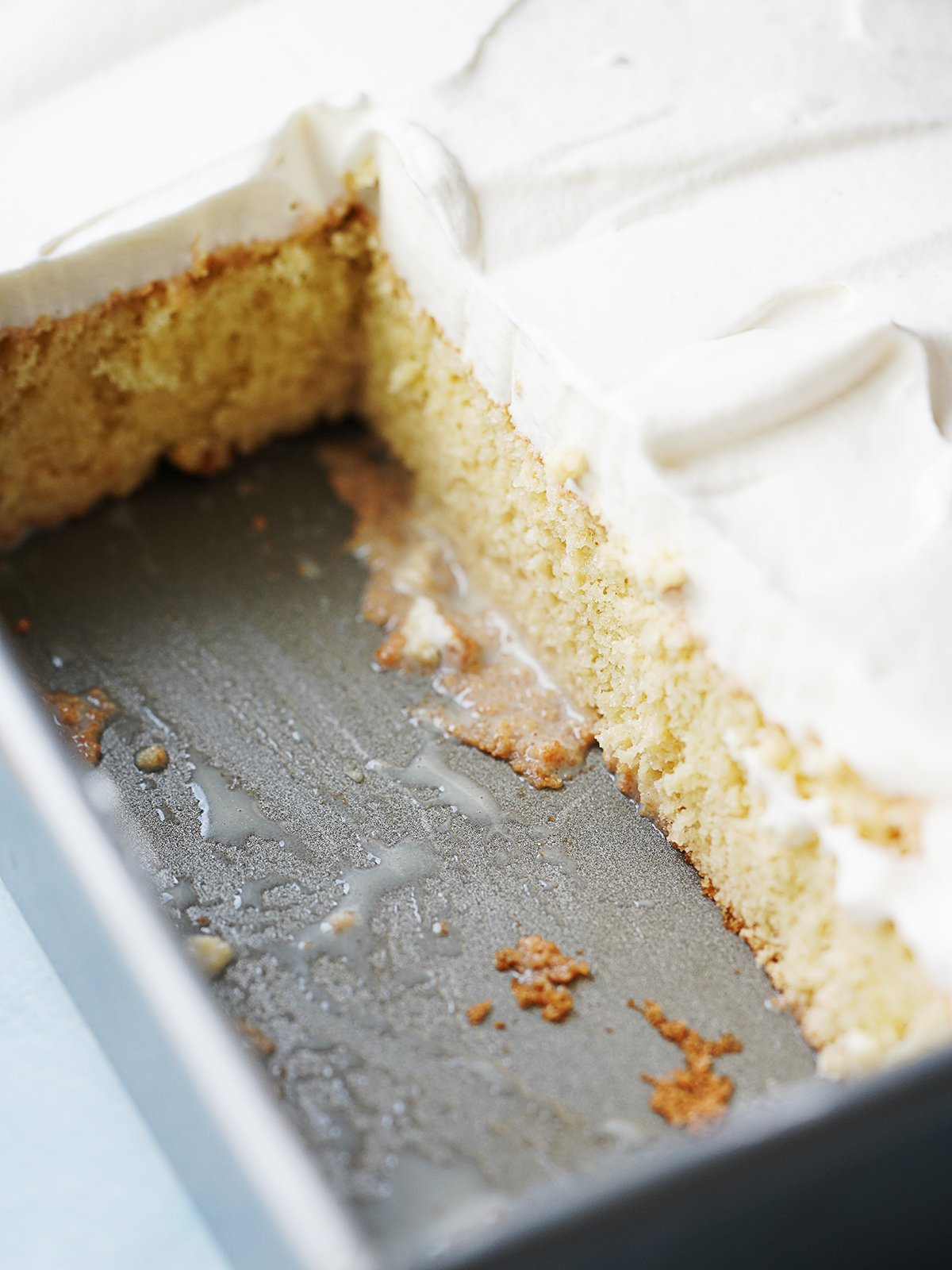 Cake in a rectangular baking pan with slices cut out.