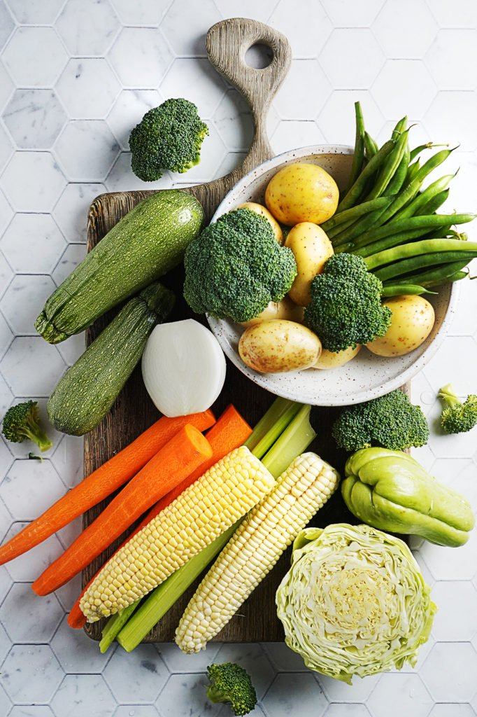 Whole Vegetables on a cutting board
