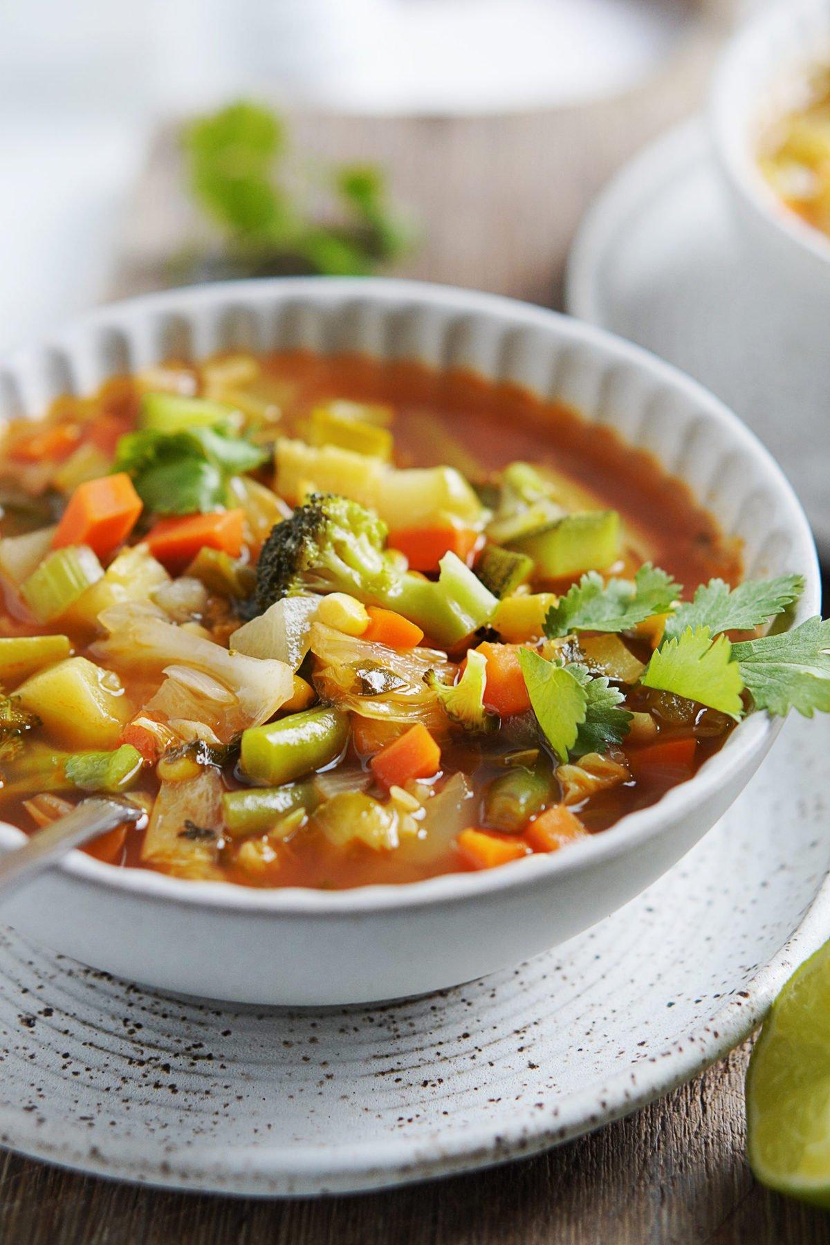 A white bowl with Sopa De Vegetales