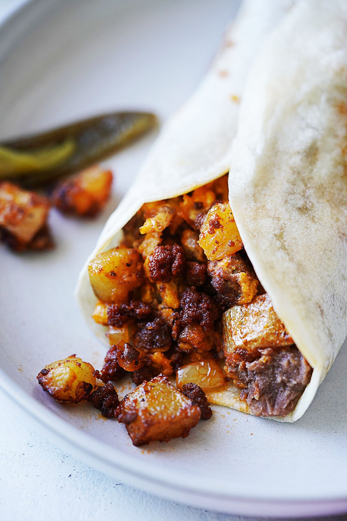 a burrito made with chorizo and potatoes and a little refried beans.