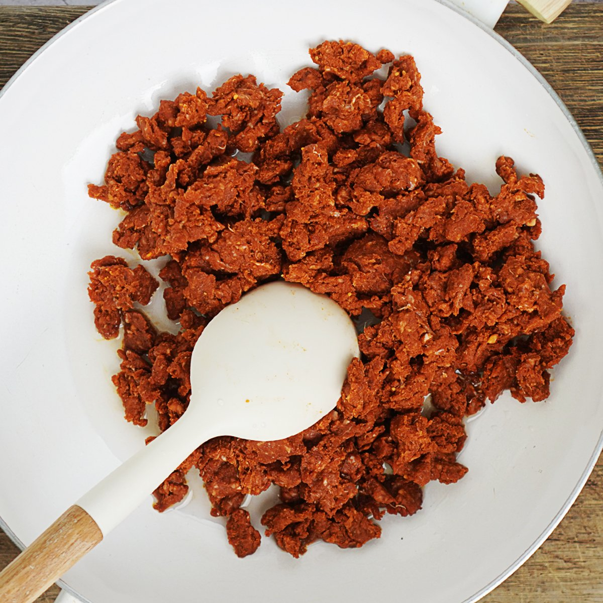 Starting to cook chorizo in a white pot