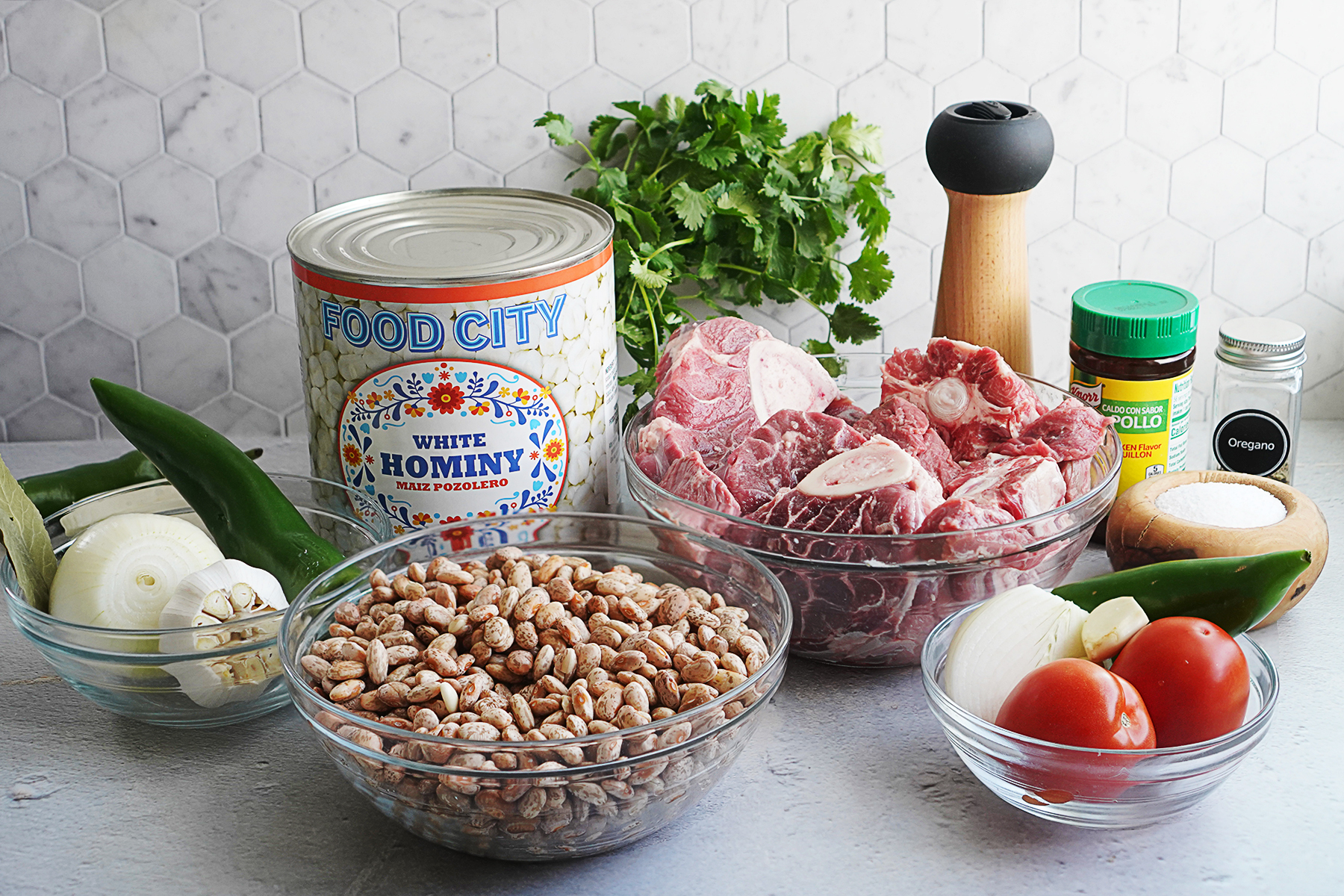 Ingredients: hominy in a can, pinto beans, onions, garlic, beef, tomato, and spices