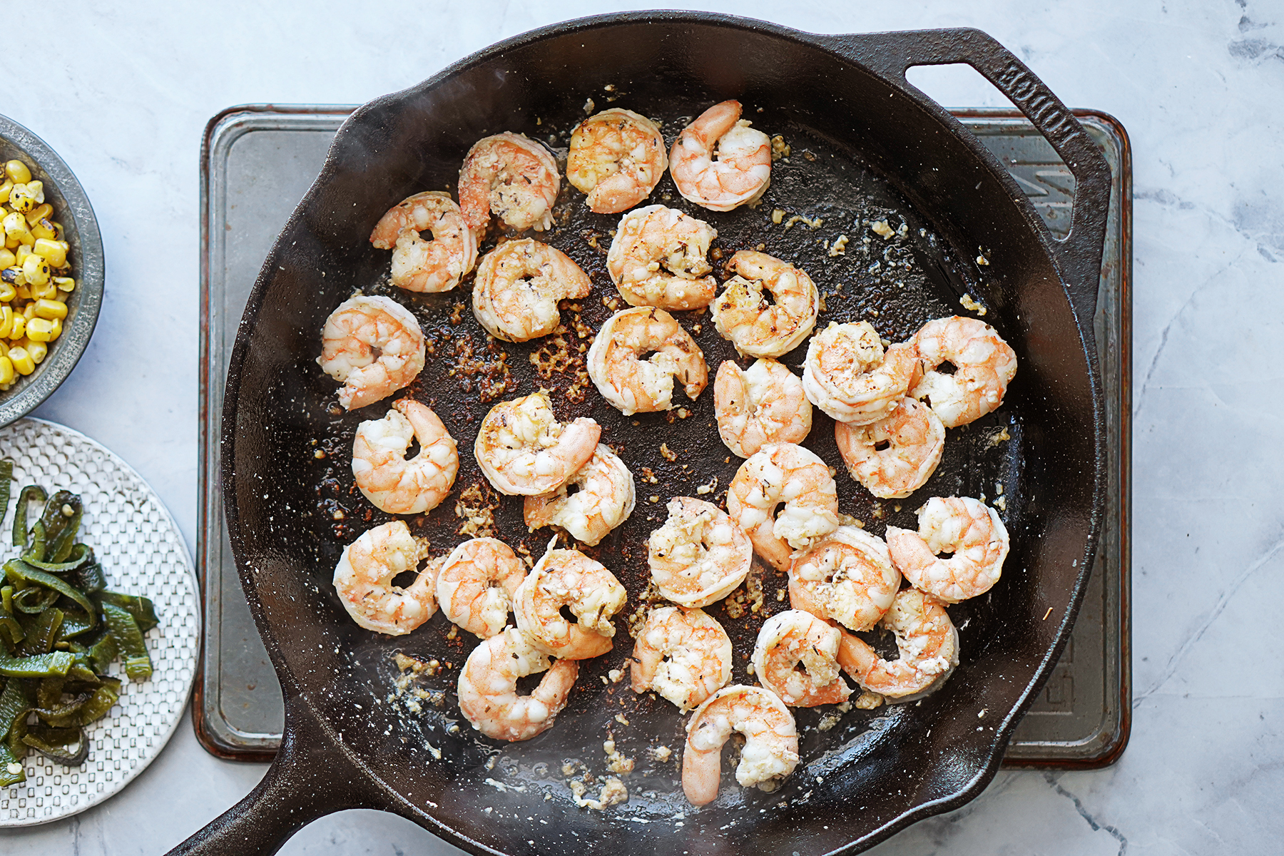 Cooked shrimps on a cast iron skillet