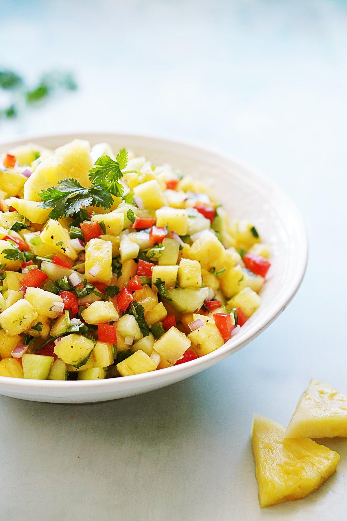 Pineapple salsa in a pretty white bowl