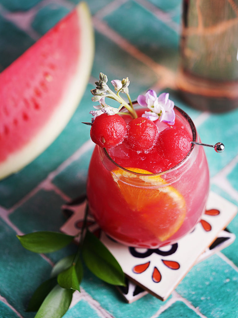Watermelon sangria in a glass garnished with watermelon balls