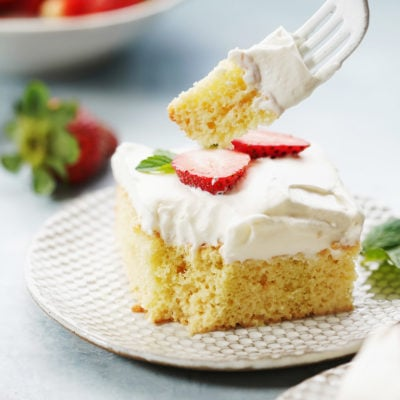 a slice of Tres leches cake with a fork