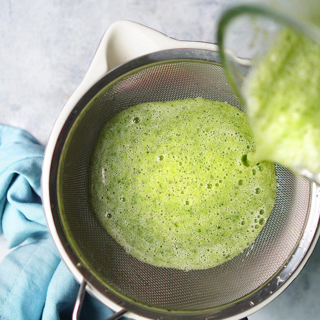Straining cucumber juice thru a fine strainer