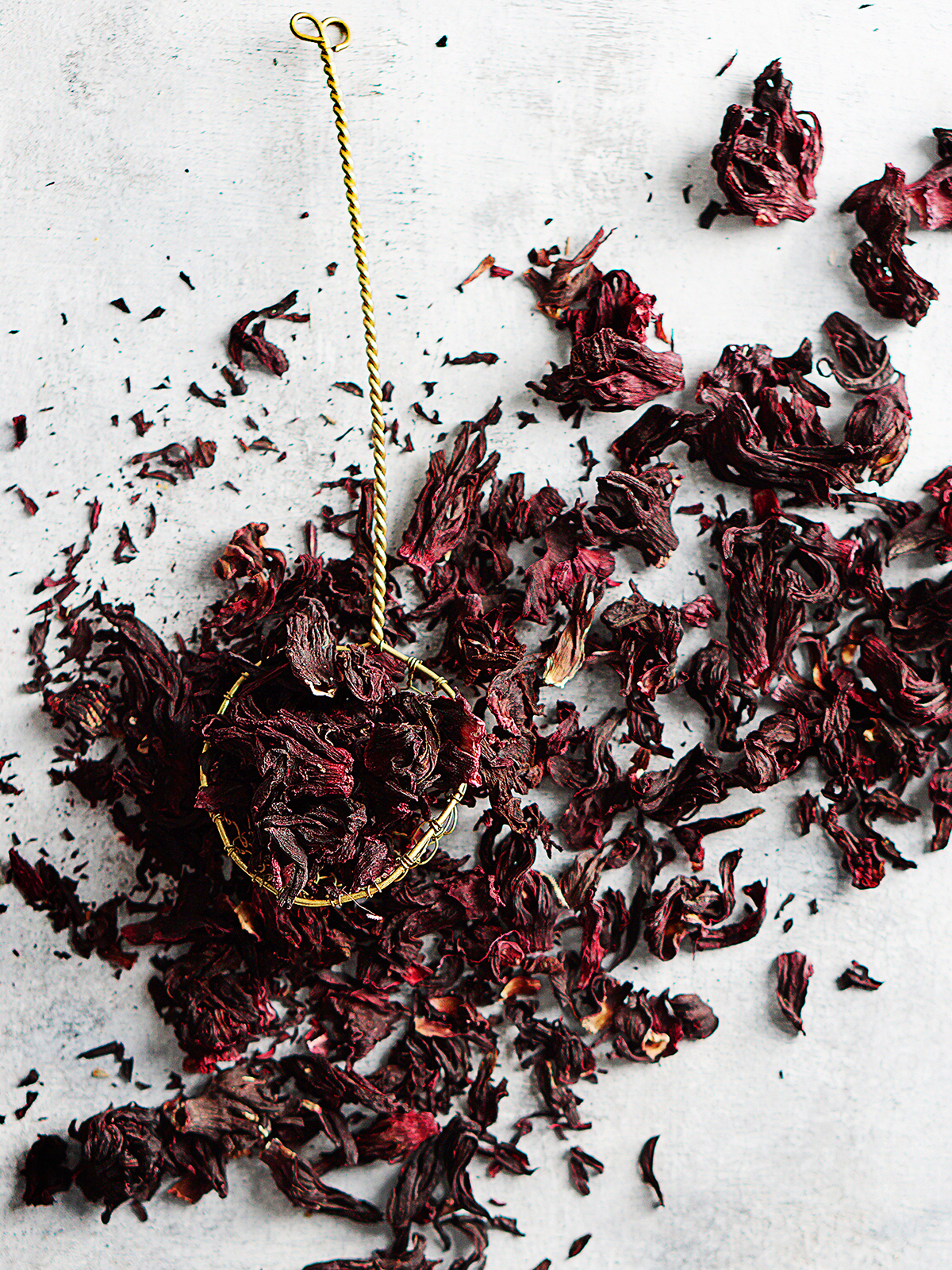 Dried roselle flowers scattered on a blue background