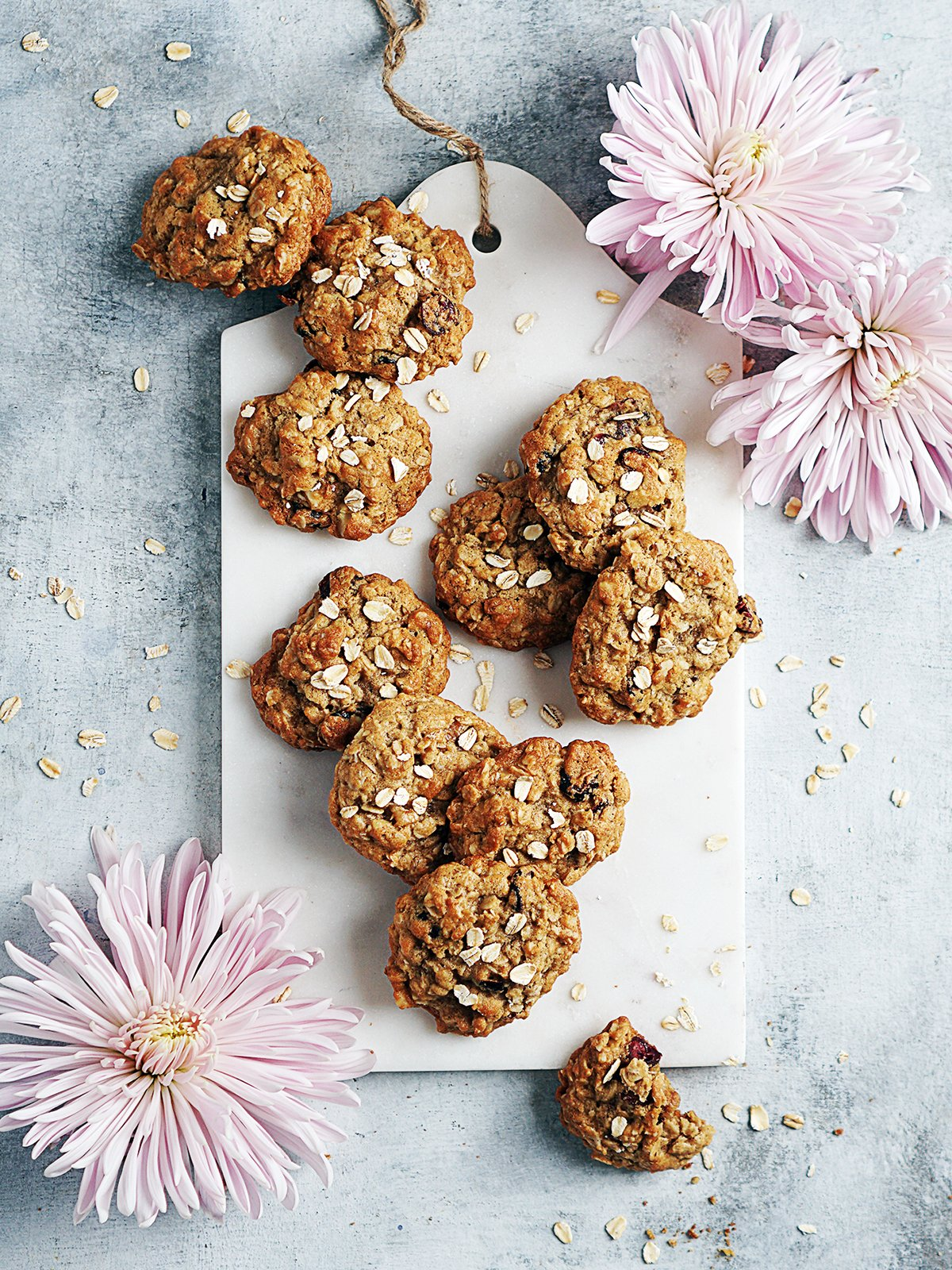 Galleas De Avena on a marble cutting board with 3 pretty pink flowers