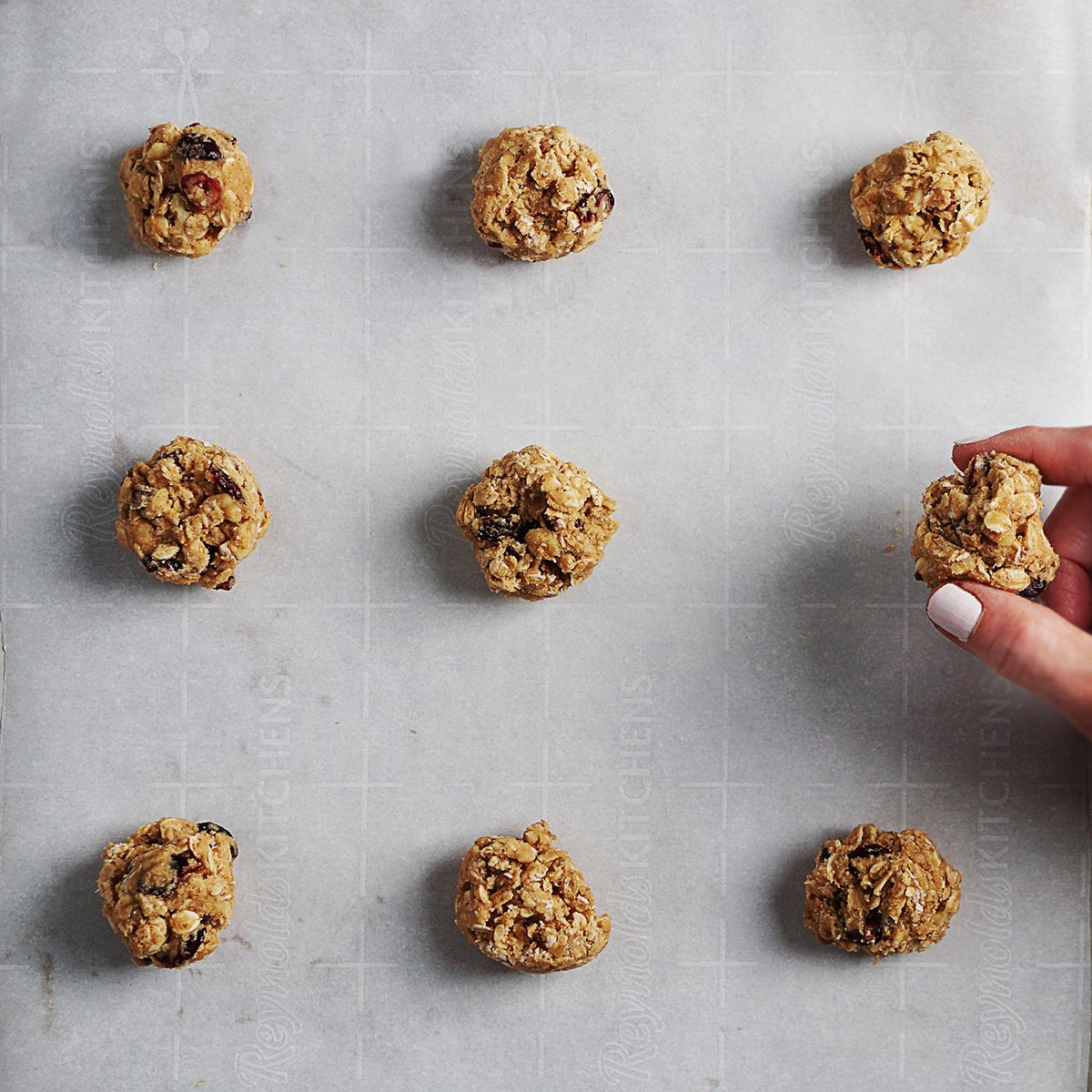 Raw cookie dough balls on a baking tray