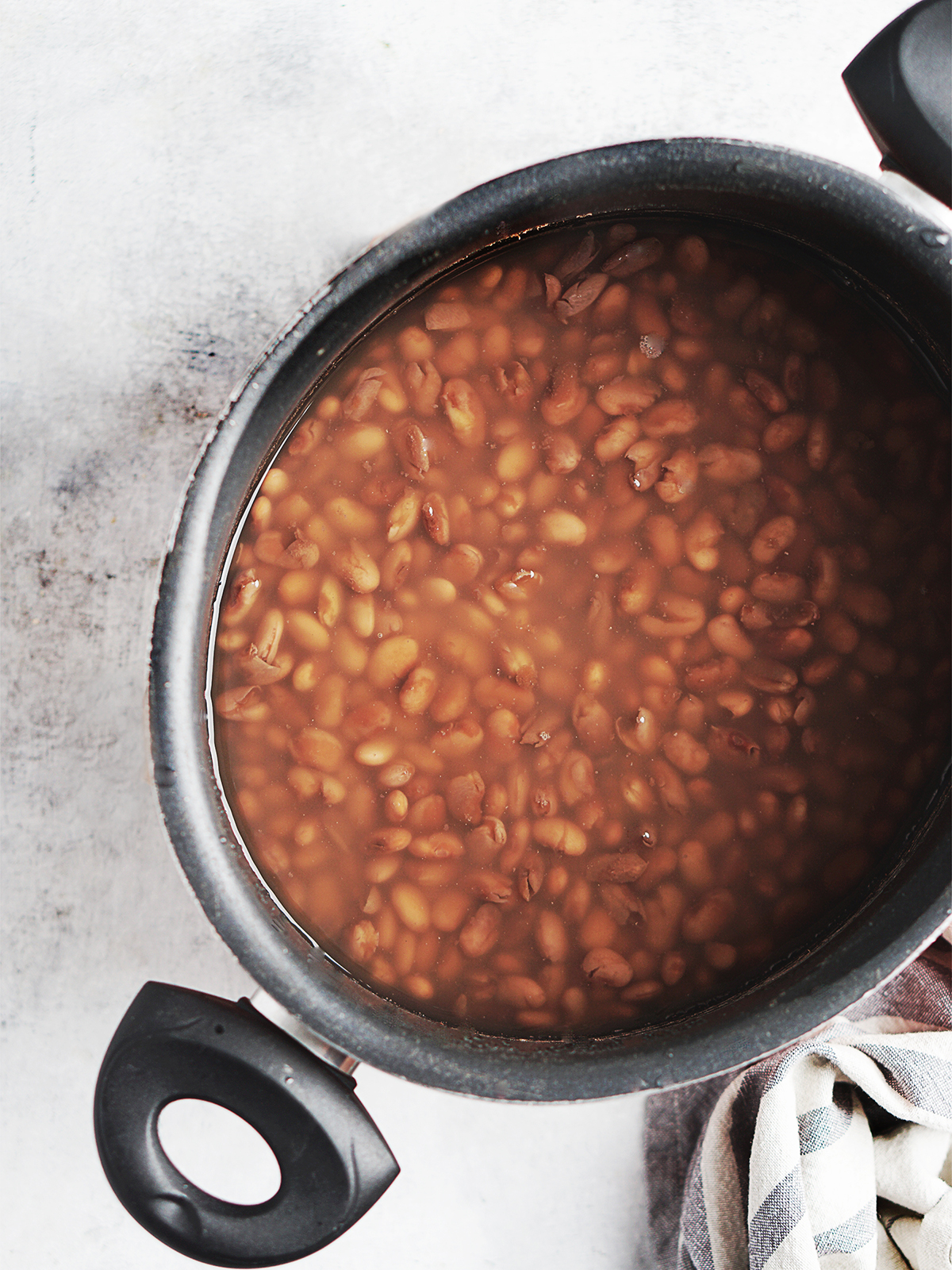 freshly cooked beans with liquid in a medium pot