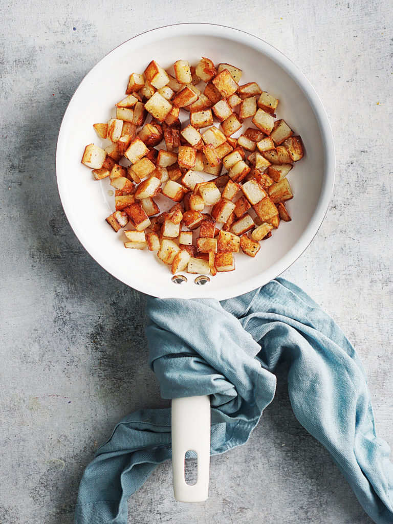 Fried potatoes in a small skillet