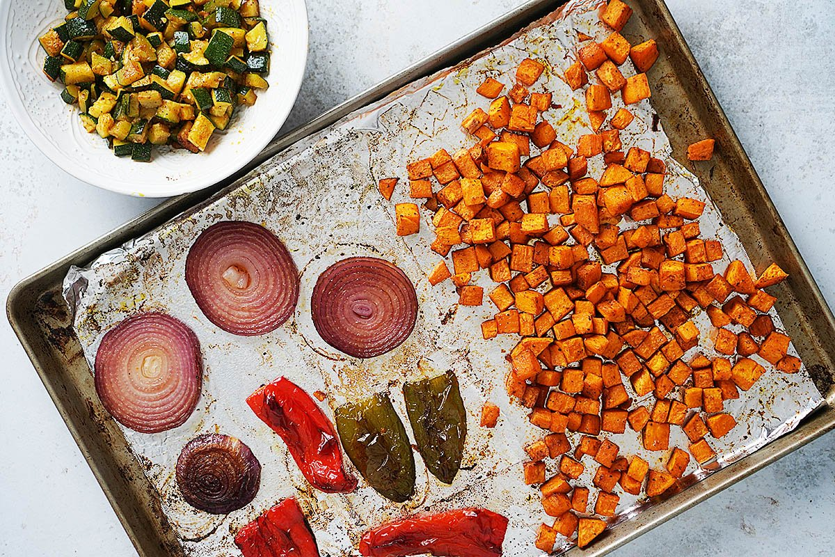 a baking tray with roasted vegetables