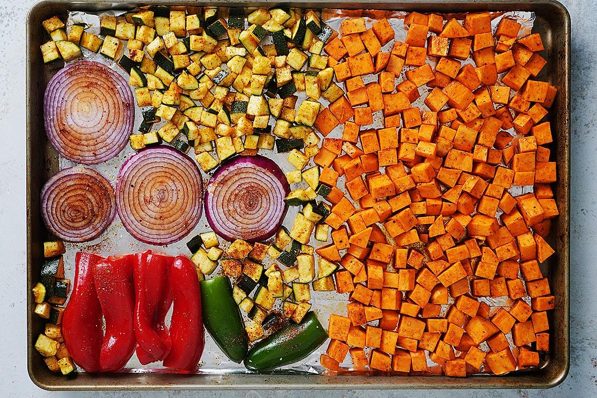Sliced vegetables on a baking sheet