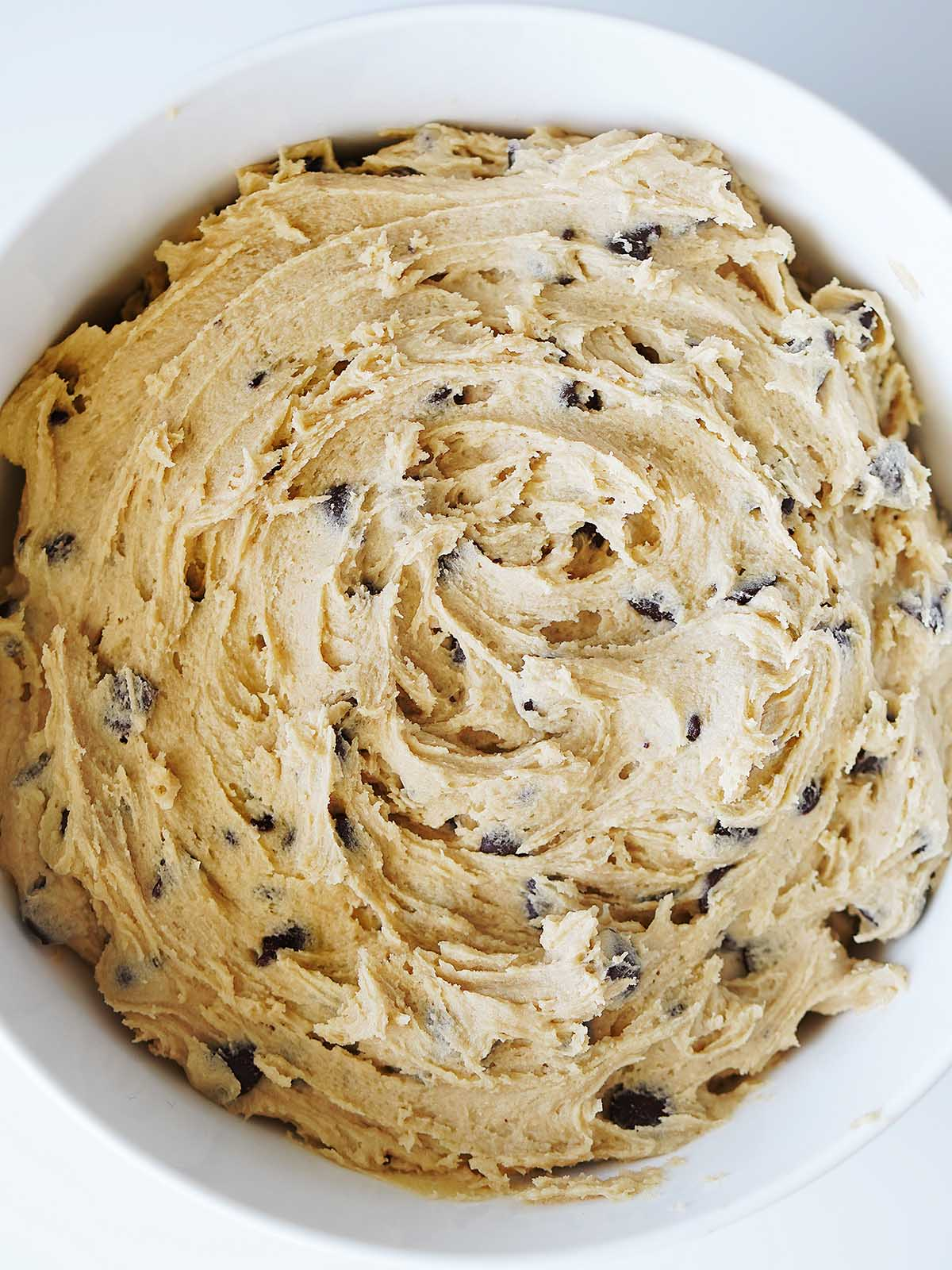 Cookie dough in a white bowl.