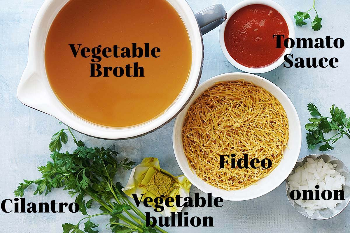 Ingredients in bowls: vegetable broth, tomato sauce, fideo, cilantro, vegetable bullion, and chopped onion.