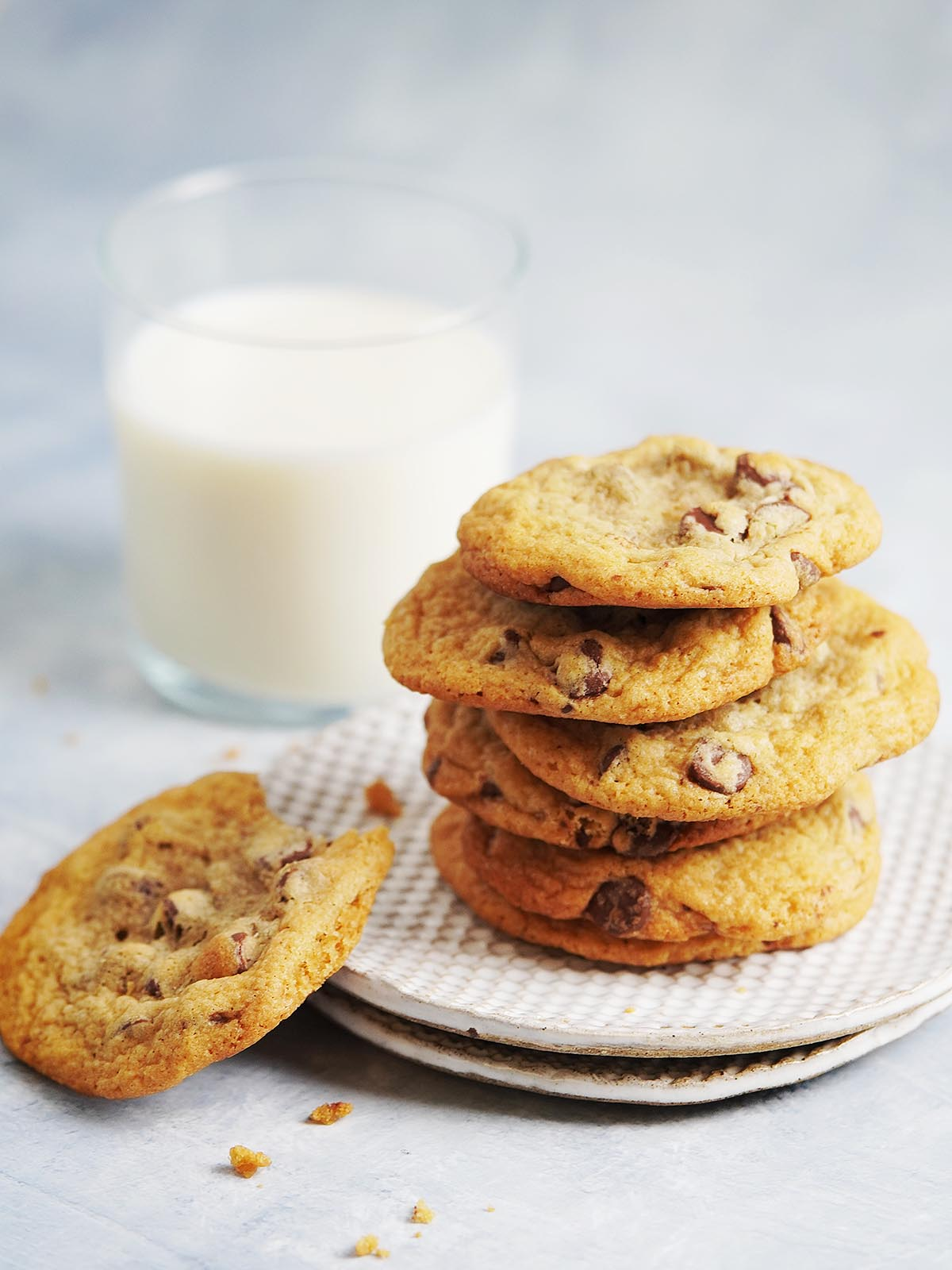 A stack of cookies on two white plates