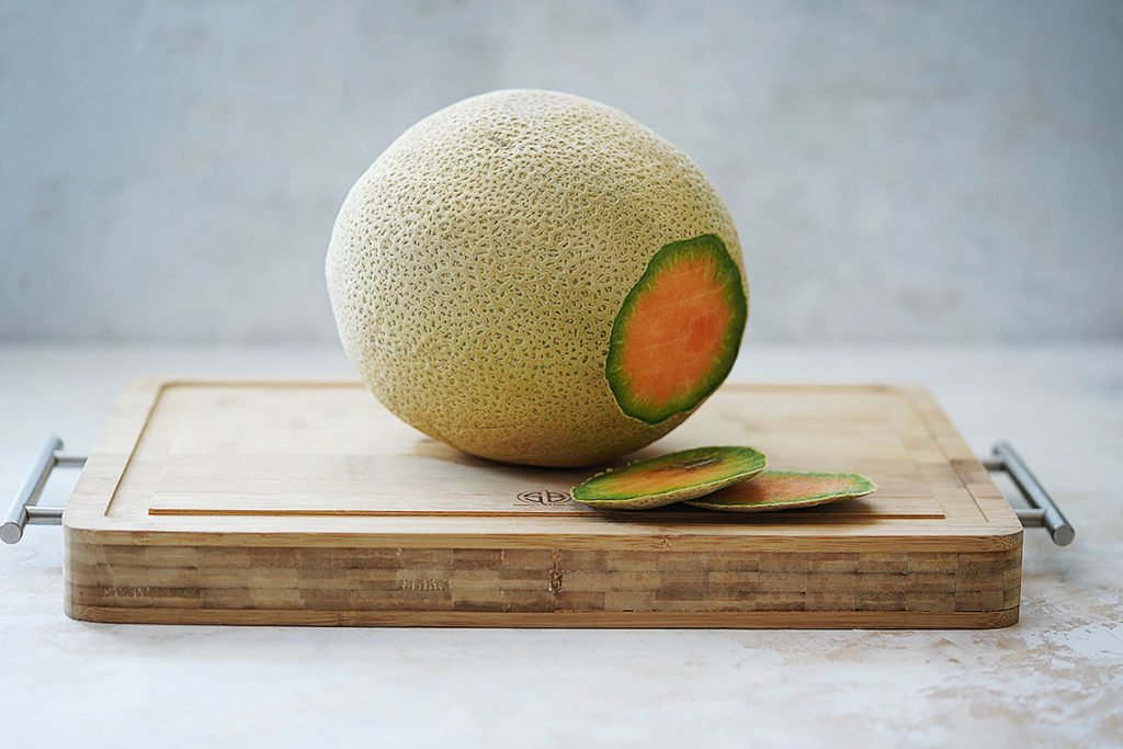 A cantaloupe with the ends cut off.