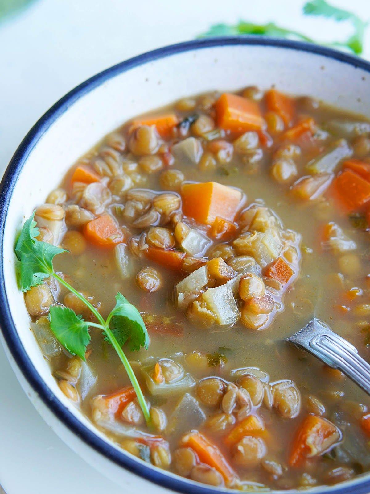 A close up image of sopa de lentejas.