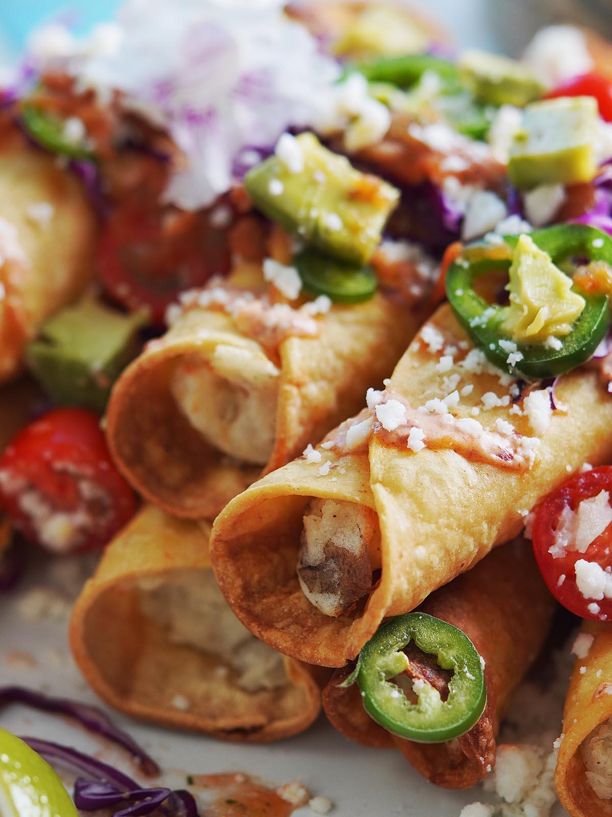 Close up image of crispy taquitos.