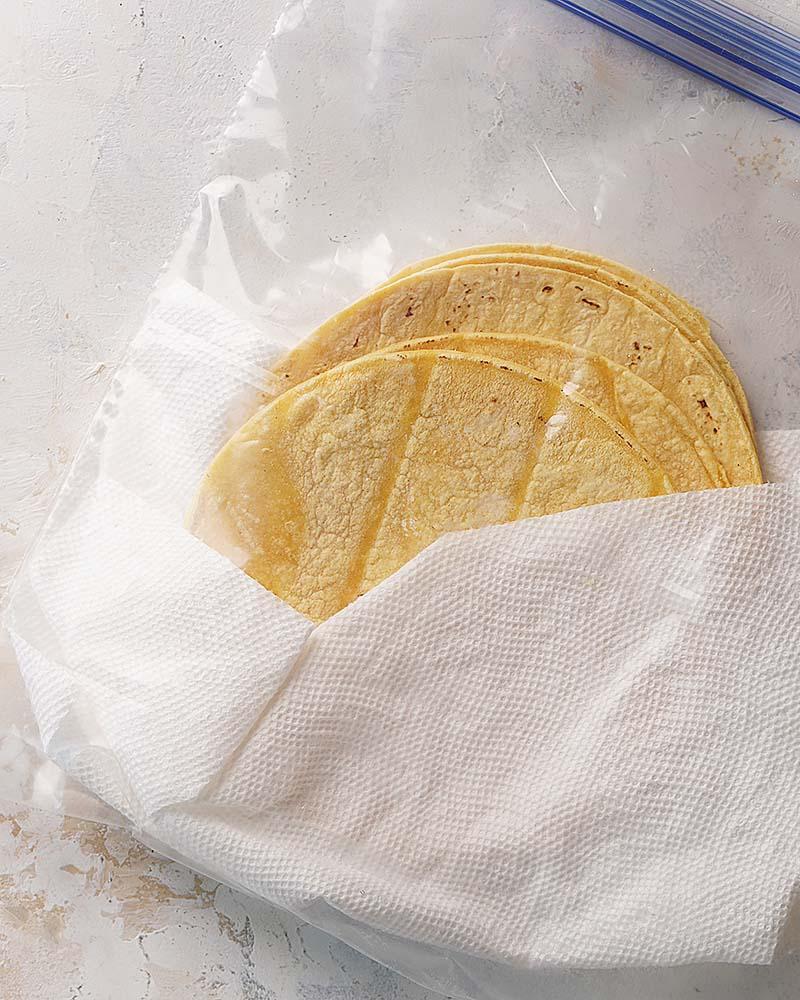 Corn tortillas placed inside a large ziploc bag.