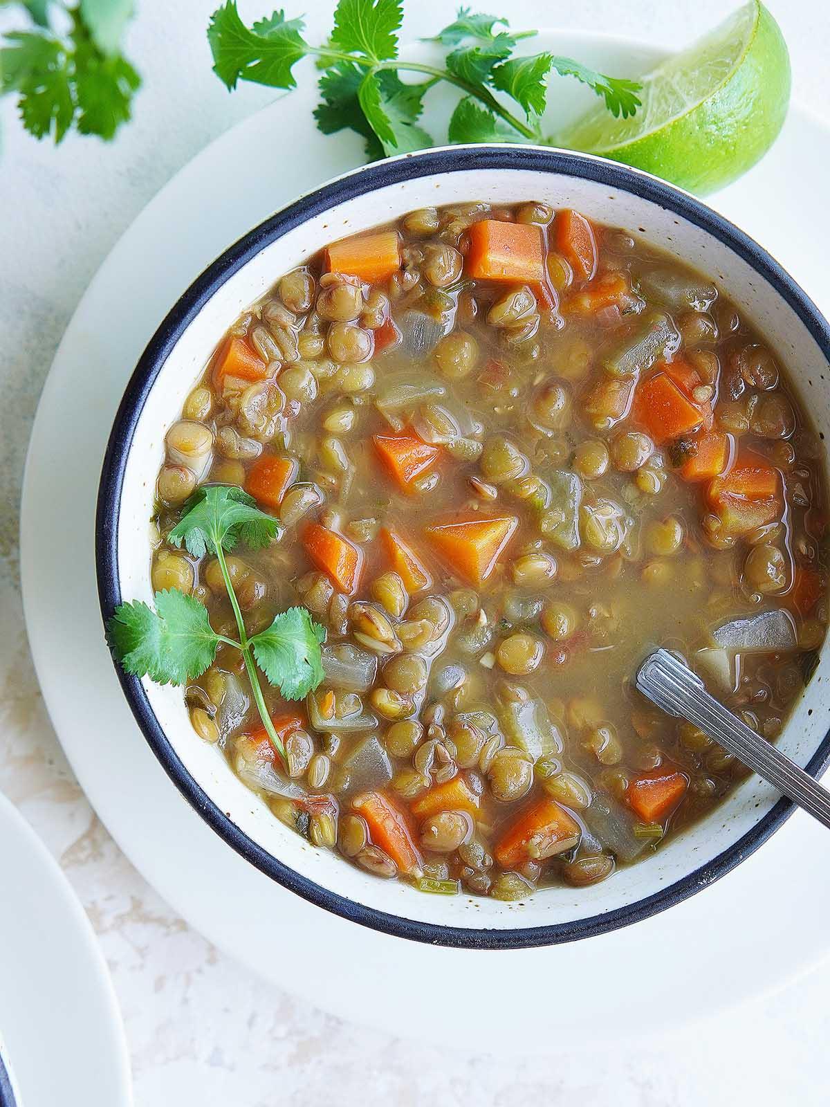 A white bowl with lentil soup