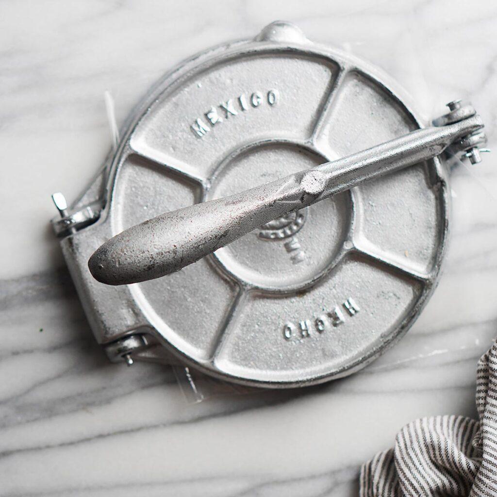 An image of a metal tortilla press.